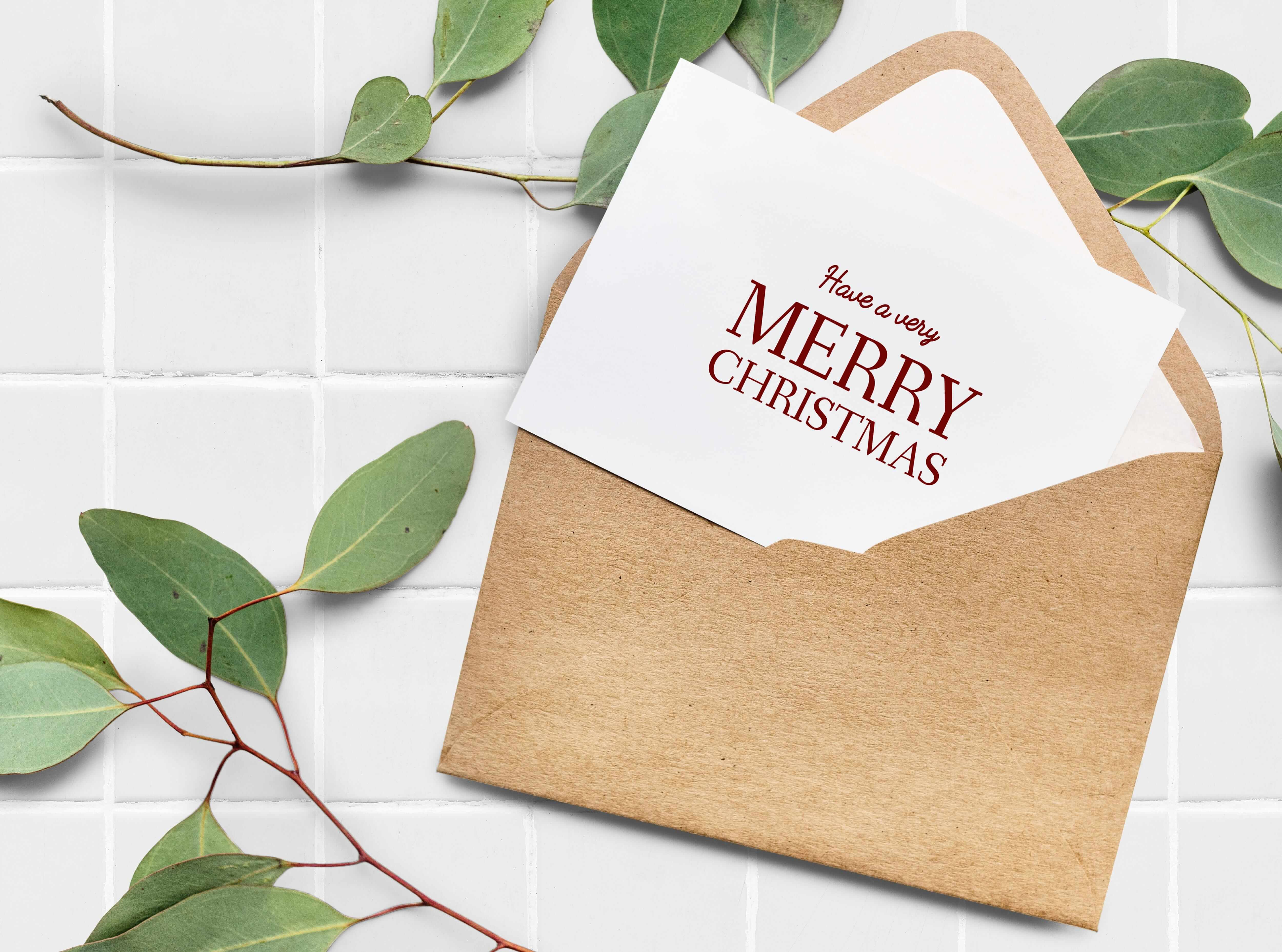 Upclose of a Christmas card with a craft paper envelope